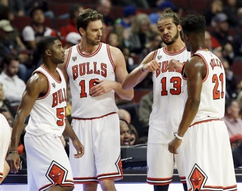 chicago bulls centerforward joakim noah 13 talks to guard etwaun moore 55 forwardcenter pau gasol 16 and guard jimmy butler 21 during the first half of an nba preseason basketball game against the detroit pistons on wedn